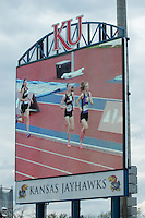 Hannah Long and Stephanie Jenks are seen on the videoboard at Rock Chalk Park during the 1600-meters at the 2015 Kansas Relays.