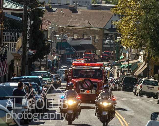 September 20, 2004 Sonora, California --Tuolumne Fire –-  CDF engine 4474 with firefighter Eva Marie Schicke's casket leads the procession on Highway 49 from the funeral home in Sonora. The memorial service for the fallen firefighter was held at the Calaveras County Fairgrounds.  The Tuolumne Fire was a small very fast-moving fire that started around noon on September 12, 2004 near Lumsden Bridge at the bottom of the Tuolumne River.  The fire moved rapidly up the 80-plus-degree slope catching Cal Fire Helitack firefighters, tragically killing firefighter Eva Marie Schicke and injuring five others.