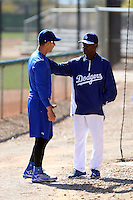 Alex Guerrero (L) and special instructor Manny Mota (R) of the Los Angeles Dodgers participates in spring training workouts at Camelback Ranch on February 11, 2014 in Glendale, Arizona (Bill Mitchell)