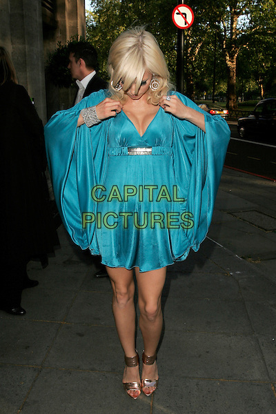 SEPTEMBER (Petra Eos Marklund).The Sony Radio Academy Awards 2009, Grosvenor House Hotel, Park Lane, London, England..May 11th, 2009.full length blue silk satin dress sleeves silver bracelet artist hands gold sandals looking down cleavage .CAP/AH.©Adam Houghton/Capital Pictures.