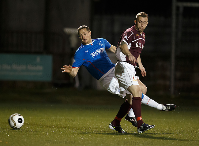 Jon DAly knocked over in the box by Kevin McKinlay but no penalty