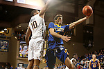 SIOUX FALLS, SD - NOVEMBER 26:  Sergio El Darwich #4 from South Dakota State University takes the ball to the basket against Isaac Banks #10 from East Tennessee State University during their game at the Sanford Pentagon Saturday evening in Sioux Falls. (Photo by Dave Eggen/Inertia)