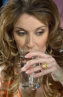 April 03, 2002, Montreal, Quebec, Canada; <br /> <br /> Singer Celine Dion show her ring while drinking a glass of water,  during a press conference, with Rene Angelil, her husband and manager, April 03, 2002, in Montreal, Canada.<br /> <br /> Her new album is at the number one in 18 countries<br /> <br /> Her husband Rene Angelil finds himself fending off a civil suit alleging assault and sexual battery, that apparently happened two years ago in Las Vegas.<br /> <br /> Photo by (c) 2002, Pierre Roussel / Images Distribution<br /> <br /> NOTE :  D-1  original JPEG, saved as Adobe 1998 RGB