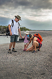 GALAPAGOS ISLANDS, ECUADOR, individuals walking on the beach on Fernandina Island