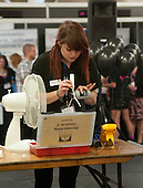 An apprentice demonstrating how to build a wind turbine, Kent2020Vision show, County Showground, Kent.