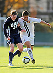 15 October 2008: University of New Hampshire Wildcats' midfielder A.J. DuBois (25), a Senior from Acworth, N.H., battles University of Vermont Catamounts' midfielder Ryan White (18), a Sophomore from Eugene, OR, at Centennial Field, in Burlington, Vermont. The Wildcats and Catamounts battled in overtime to a 0-0 tie...Mandatory Photo Credit: Ed Wolfstein Photo