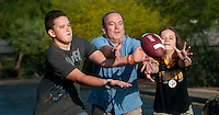 Clint Bolick and his wife Shawnna, find common ground with thier son Ryne, 13, and Kali, 10, hiking, playing football and on other activities in their neighborhood.