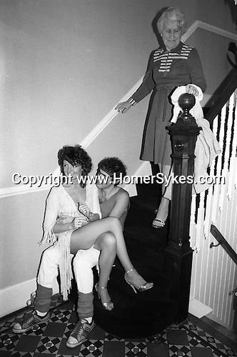 "Grandmother comes down the stairs at a so called ""Hot Chocolate"" party named after the pop group of the time. Suburban middle class fancy dress party. Wimbledon SW19. England. 1983."