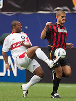 Andy Williams of the Fire and Craig Ziadie of the MetroStars go for the ball. The Chicago Fire defeated the NY/NJ MetroStars 3-2 on 6/14/03 at Giant's Stadium, NJ..