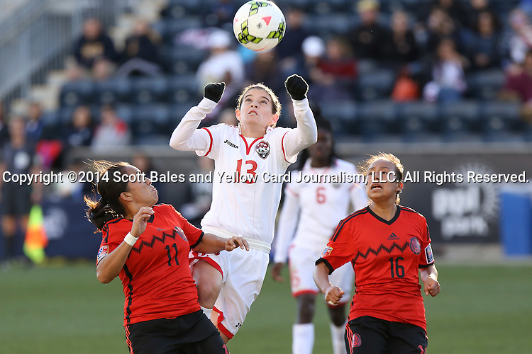 26 October 2014: Anique Walker (TRI) (13) heads the ball over Monica Ocampo (MEX) (11) and Karla Nieto (MEX) (16). The Trinidad & Tobago Women's National Team played the Mexico Women's National Team at PPL Park in Chester, Pennsylvania in the 2014 CONCACAF Women's Championship Third Place game. Mexico won the game 4-2 after extra time. With the win, Mexico qualified for next year's Women's World Cup in Canada and Trinidad & Tobago face playoff for spot against Ecuador.