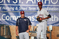 Mahoning Valley Scrappers pitching coach Tighe Dickinson (37) watches starting pitcher Triston McKenzie (23) warm up before a game against the Auburn Doubledays on July 19, 2016 at Falcon Park in Auburn, New York.  Mahoning Valley defeated Auburn 9-1.  (Mike Janes/Four Seam Images)