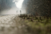 Paris-Roubaix 2013 RECON at Bois de Wallers-Arenberg..riders approaching through the dust