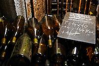 old bottles in the cellar chalk board bouchard p & f beaune cote de beaune burgundy france