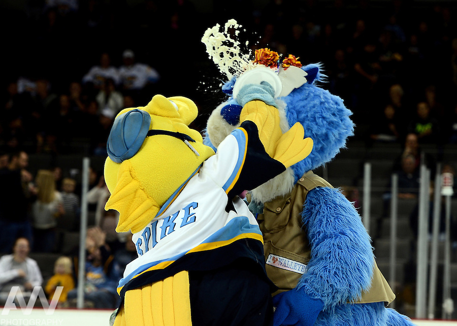 Oct 19, 2012; Toledo, OH, USA; Toledo Walleye mascot CatTrick and Spike against the Cincinnati Cyclones at Huntington Center: Mandatory Credit: Andrew Weber
