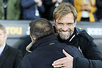 (L-R) Swansea manager Carlos Carvalhal is embraced by Liverpool manager Jurgen Klopp during the Premier League match between Swansea City and Liverpool at The Liberty Stadium, Swansea, Wales, UK. Monday 22 January 2018