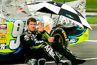 Carl Edwards, driver of the No. 99 Ford Aflac car for Roush Fenway Racing, waits out the rain during the 2009 Coca-Cola Classic 600 race at the Lowe's Motor Speedway, in Concord, NC. NASCAR Driver David Reutimann ultimately won the race, and his first Sprint Cup, during the rain-shortened event, held May 25, 2009. NASCAR's longest scheduled race went only 227 laps, or 340.5 miles, before officials ended it because of rain. The 2009 race was the 50th running of the Coca-Cola 600. Ryan Newman and Robby Gordon finished second and third respectively.