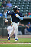 Adonis Paula (16) of the Myrtle Beach Pelicans hustles down the first base line against the Winston-Salem Dash at BB&T Ballpark on May 11, 2017 in Winston-Salem, North Carolina.  The Pelicans defeated the Dash 9-7.  (Brian Westerholt/Four Seam Images)