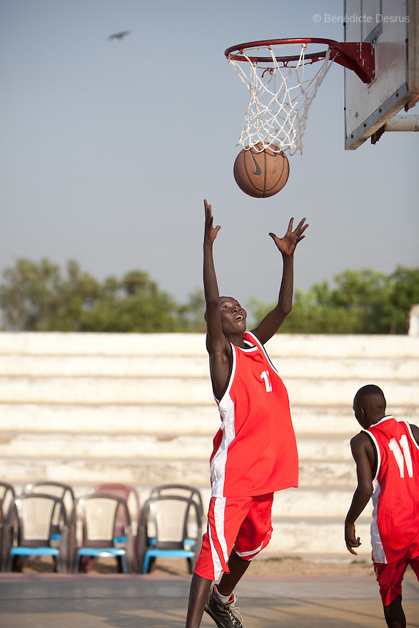 January 7, 2011 - Juba, Sudan - Southern Sudanese basektball players compete in a local match in Juba basketball stadium in Nimra Talata, two days before the start of a landmark vote on independence after five decades of conflict between south and north of Sudan. If there is one thing south Sudan is famous for in the outside world, it is the super lofty stars with which it has studded the NBA and now, as nationhood beckons, it is basketball that it is looking to make a name in international sports. Photo credit: Benedicte Desrus
