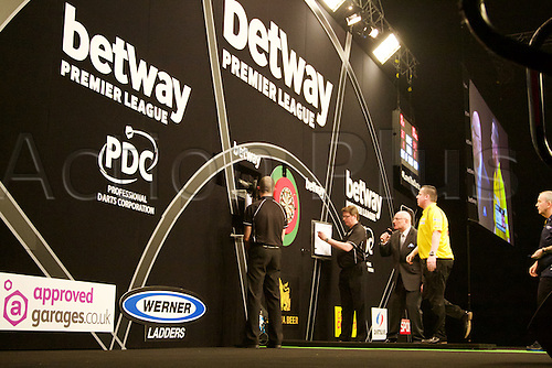 2.04.2015.  Manchester, England. Betway Premier League Darts. Judgement Night. Dave Chisnall retrieves his darts