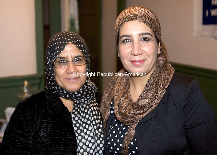 NAUGATUCK CT. 09 November 2013-110913SV27-From left, Fatemeh Amiri of Waterbury and Najia Nasiri of Waterbury attend The Jubilee Community Service Organization&rsquo;s dinner dance at Saint Michael's Church Hall in Naugatuck Saturday.<br /> Steven Valenti Republican-American