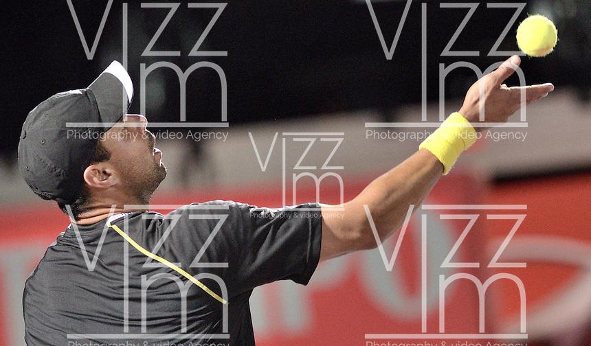 BOGOTÁ -COLOMBIA. 19-07-2013. Alejandro Falla (COL) durante el juego con Janko Tipsarevic (SRB) en cuartos de final del ATP Claro Open Colombia 2013 en el Centro de Alto Rendimiento en la ciudad de Bogotá./ Alejandro Falla (COL) during match against Janko Tipsarevic (SRB) in final-quaters of the ATP Claro Open Colombia 2013 at Centro Alto Rendimiento in Bogota city. Photo: VizzorImage / Str