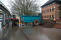 "17/01/17 **WITH VIDEO**<br /> <br /> A muck tractor and trailer has dumped its full load on the steps of Derby Crown Court this morning.<br /> <br /> The driver left his filthy cargo spread out over the stairs and pathway to the court house in an apparent protest against ""a severely flawed judicial system"", according to a printed sign left in his cab.<br /> <br /> It read: "" What a shame!!! What a shame to have to resort to this. Today is a personal protest against the severely flawed judicial system that has consistently failed to listen to simple truth and reason. Sorry for any inconvenience caused (to the general public)""<br /> <br /> David Carter from Derby was passing by on his bike when it happened: ""He was spreading the muck all over the steps when I went past, it was quite a mess. I'd love to know why he felt he had to resort to such a measure, but he didn't want to say anything to me.""<br /> <br /> Andrew Simpson, from Derby, saw it and said: ""I wondered what what going on when I saw the tractor and trailer stop outside the court so I decided to stay and see what happened. He didn't say why he was doing it, but said there was a note in his tractor cab that explained it. Fair play to the chap - he was fed up and he got his message across.""<br /> <br /> Julie Adams from Sinfin said: ""There was an awful lot when he had just done it, but it's being cleaned up quickly. What a mess. But thank goodness it wasn't manure, that would have been horrid.""<br /> <br /> All Rights Reserved: F Stop Press Ltd. +44(0)1773 550665   www.fstoppress.com"