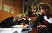 A wealthy Dutch teenager looks bored during class at a school in Bussum, in the affluent Gooi region in the centre of the Netherlands. The teachers and students are pre-dominantly white..Picture shot in Amsterdam in 2004 by Justin Jin. .