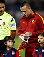 "Calcio, Serie A: Roma, stadio Olimpico, 25 ottobre 2017.<br /> Roma's Radja Nainggolan holds the book of holocaust victim Anne Frank before the Italian Serie A football match between AS Roma and Crotone at Rome's Olympic stadium, October 25, 2017.<br /> Few days ago Lazio fans posted anti-semitic photos of Anne Frank in a Roma jersey in the stands of the Stadio Olimpico. The Italian football federation announced that there will be a minute's reflection on the Holocaust before every match and a passage read from ""The Diary of Anne Frank"". At the same time referees and captains will hand out copies of the diary and Italian Jewish writer Primo Levi's memoir ""If This Is A Man"".<br /> UPDATE IMAGES PRESS/Isabella Bonotto"