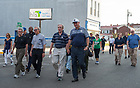 August 13, 2017; University of Notre Dame President Rev. John I. Jenkins, C.S.C., Jack Brennan, chairman of the University of Notre Dame's Board of Trustees, and Governor Eric Holcomb join the pilgrims as they walk the first two miles to Kimmell Park in Vincennes, Indiana. <br />