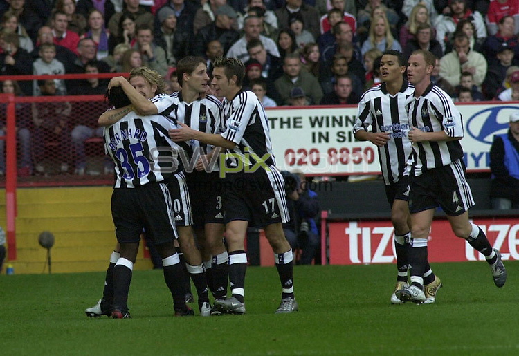 PIX: Football. Barclays Premiership. Charlton Athletic-Newcastle United, The Valley, 17th October 2004...COPYRIGHT PICTURE>> SIMON WILKINSON>>0870 092 0092>>....Craig Bellamy celebrates putting Newcastle1-0 up.......The Premier League granted Charlton permission to wear their special centenary kit against Newcastle. The match also marked Alan Curbishley's 650th league and cup game in charge of the club, as well as being the 100th Premiership game at The Valley. Jonathan Fortune was also making his 100th career league appearance, whilst Jason Euell celebrated his 300th league and cup game...