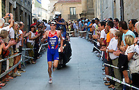 25 JUN 2011 - PONTEVEDRA, ESP - Dmitry Polyansky (RUS) leaves the old town part of the run course during the Elite Men's European Triathlon Championships in Pontevedra, Spain .(PHOTO (C) NIGEL FARROW)
