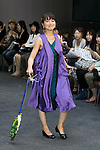 Singer Ayako Ozawa poses on the catwalk wearing clothes from the tenbo 2016 Spring-Summer Collection during the Mercedes-Benz Fashion Week Tokyo, in Roppongi on October 13, 2015, Tokyo, Japan. tenbo invited people with disabilities to join models and celebrities on the runway in a message of peace. The Mercedes-Benz Fashion Week Tokyo runs from October 12 to 17. (Photo by Rodrigo Reyes Marin/AFLO)