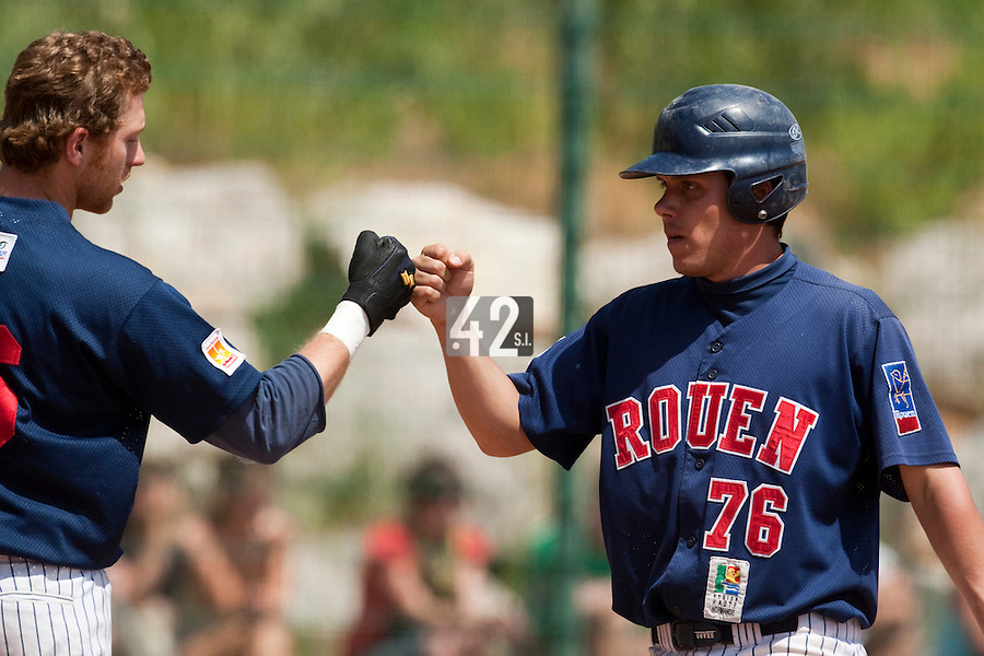 24 May 2009: Boris Marche of Rouen is congratulated by Nicolas Dubaut during the 2009 challenge de France, a tournament with the best French baseball teams - all eight elite league clubs - to determine a spot in the European Cup next year, at Montpellier, France. Rouen wins 7-5 over Savigny.