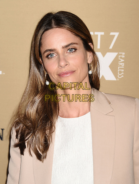 LOS ANGELES, CA - OCTOBER 03: Actress Amanda Peet arrives at the premiere screening of FX's 'American Horror Story: Hotel' at Regal Cinemas L.A. Live on October 3, 2015 in Los Angeles, California.<br /> CAP/ROT/TM<br /> &copy;TM/ROT/Capital Pictures