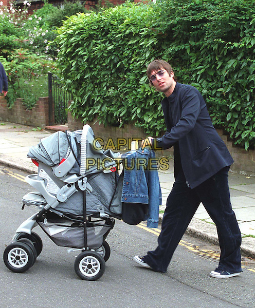 LIAM GALLAGHER.Proud Dad Taked New Baby Gene Out For A Stroll In Hampstead.celeb parent, paparazzi pix, full length, full-length, buggy.www.capitalpictures.com.sales@capitalpictures.com.© Capital Pictures