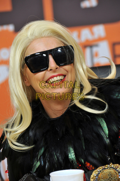 Victoria Cluskey (Maybe Gaga).MayBe GAGA show press-conference, Saint Petersburg, Russia..November 19th, 2012.headshot portrait costume sunglasses shades black feather jacket lookalike  leather  .CAP/PER/VB.©VB/PersonaStars/CapitalPictures