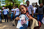 An Egyptian girl holds privately-sponsored posters of incumbent President Abdel Fattah al-Sisi on the the second day of the presidential election at a polling station, in Cairo, Egypt, on March 27, 2018. Egyptians head to the polls in a three-day vote to choose between incumbent Abdel Fattah al-Sisi and candidate Moussa Mostafa Moussa. Photo by Fayed El-Geziry