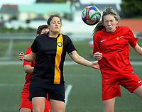 Action from the Women's Capital Premier football match between the Island Bay Sharkettes and Tawa (red) at Wakefield Park in Wellington, New Zealand on Sunday, 23 July 2017. Photo: Dave Lintott / lintottphoto.co.nz