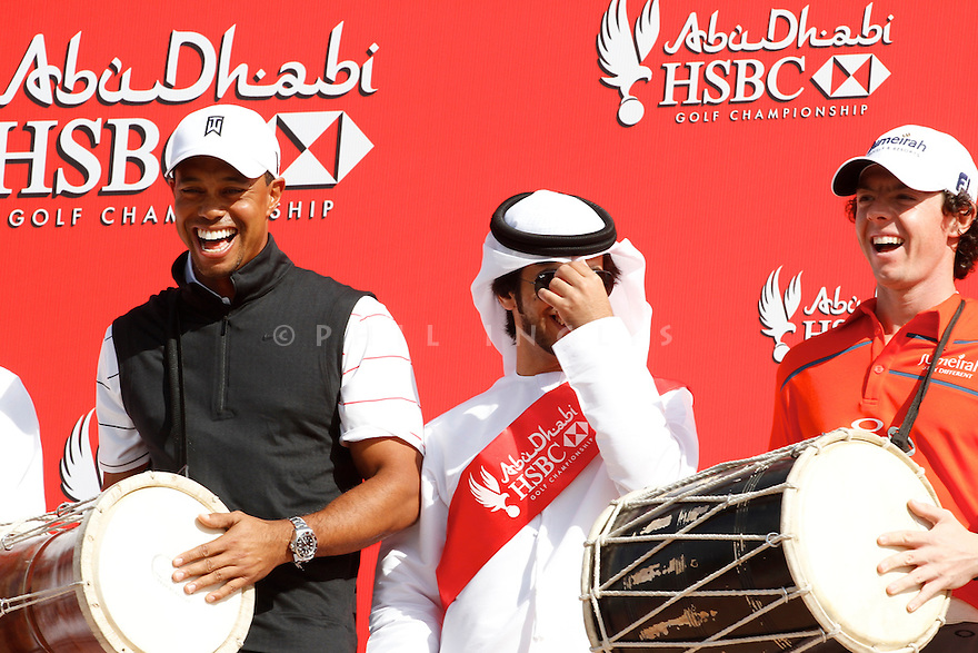 Lee Westwood (ENG),Tiger Woods (USA) and Rory McIlroy (NIR) line up for a photocall ahead of the Abu Dhabi HSBC Golf Championship played at Abu Dhabi Golf Club 26-29 January 2012.(Picture Credit / Phil Inglis)