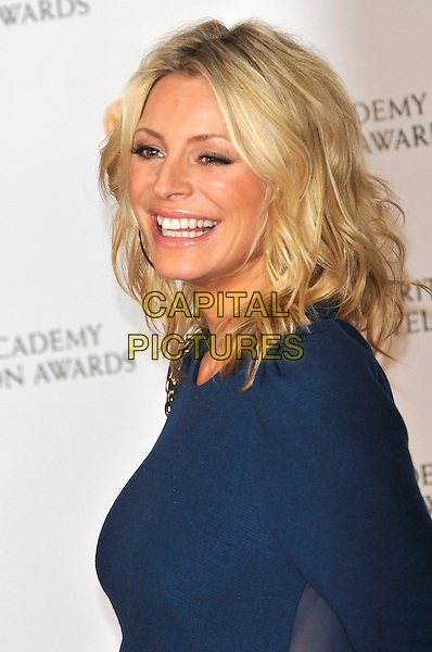 TESS DALY .Arrivals at the British Academy Television Awards 2009, Royal Festival Hall, London, England. 26th April 2009..TV Baftas bafta's portrait headshot blue gold earrings smiling profile press room.CAP/PL.©Phil Loftus/Capital Pictures