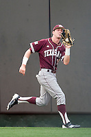 Texas A&M Aggies outfielder Tyler Naquin #18 makes a catch against the Texas Longhorns in NCAA Big XII Conference baseball on May 21, 2011 at Disch Falk Field in Austin, Texas. (Photo by Andrew Woolley / Four Seam Images)