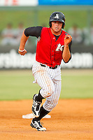 Grant Buckner (14) of the Kannapolis Intimidators takes off for third base during the South Atlantic League game against the Rome Braves at CMC-Northeast Stadium on August 5, 2012 in Kannapolis, North Carolina.  The Intimidators defeated the Braves 9-1.  (Brian Westerholt/Four Seam Images)