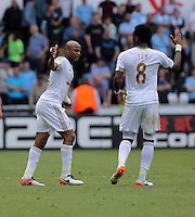 Andre Ayew of Swansea City celebrates his equaliser with team mate Leroy Fer during the Swansea City FC v Manchester City Premier League game at the Liberty Stadium, Swansea, Wales, UK, Sunday 15 May 2016