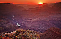 The sun sets over the Grand Canyon, seen from Lapin Point on the South Rim Drive
