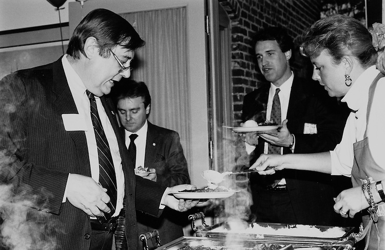 Rep. Bill Emerson, R-Mo. being served barbeque ribs, pork and beans, and cole slaw. May 18, 1989. (Photo by Laura Patterson/CQ Roll Call)