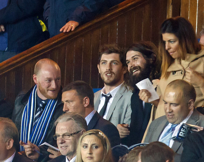 Ben Johnston and Simon Neil of Biffy Clyro with Sam McNulty of Twin Atlantic after signing autographs for Carino at Ibrox