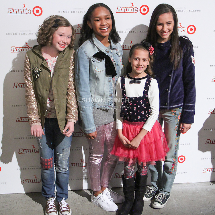 The cast of Annie arrives at the Annie For Target collection celebration and pop-up shop at Stage 37 in New York City on November 4, 2014.
