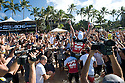 The Coolie Kids, Joel Parkinson (AUS) and Dean Morrison (AUS) carrying Mick Fanning (AUS) up the beach for his world tittle victory  during the Billabong Pipeline Masters at Backdoor on the Northshore of Oahu in Hawaii.