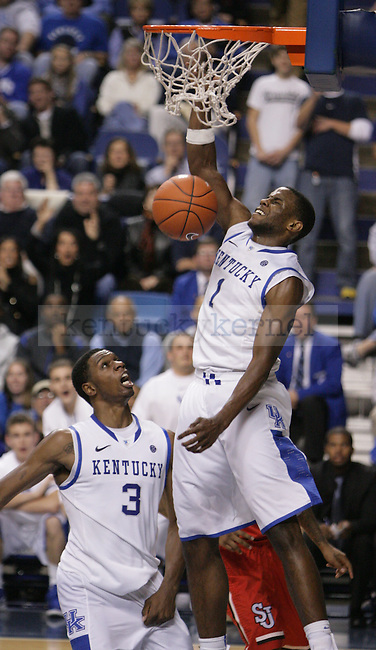 UK Senior Darius Miller slam dunks the ball during the second half of UK's home game against St. John's at Rupp Arena in Lexington, Ky., Dec. 1, 2011. Photo by Brandon Goodwin