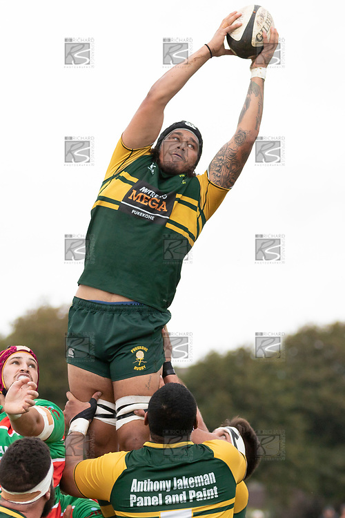 Callum Adams has to stretch to take the ball at lineout time. Counties Manukau Premier Club rugby game between Pukekohe and Waiuku, played at Colin Lawrie Fields, Pukekohe on Saturday April 14th, 2018. Pukekohe won the game 35 - 19 after leading 9 - 7 at halftime.<br /> Pukekohe Mitre 10 Mega -Joshua Baverstock, Sione Fifita 3 tries, Cody White 3 conversions, Cody White 3 penalties.<br /> Waiuku Brian James Contracting - Lemeki Tulele, Nathan Millar, Tevta Halafihi tries,  Christian Walker 2 conversions.<br /> Photo by Richard Spranger